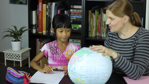 Homeschool Mom Teaches Geography To Daughter Stock Video Footage