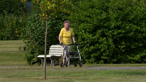 pensioner walk quickly with rollator starts 11088 Stock Video Footage