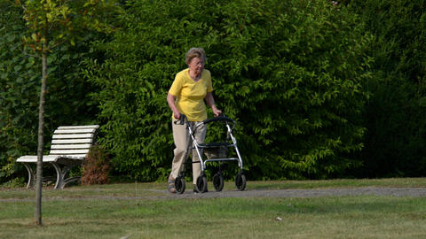 pensioner walk quickly with rollator starts 11088 Footage