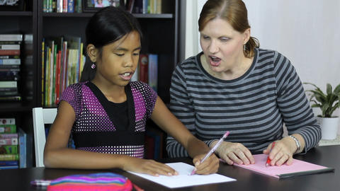 Homeschool Mom Teaches Art Lesson To Daughter Stock Video Footage