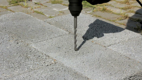 Drilling hole into concrete. Outdoor Stock Video Footage