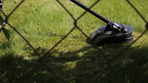 Cutting grass with lawn mower Stock Video Footage