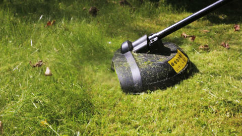Cutting grass with lawn mower. Close Up Stock Video Footage