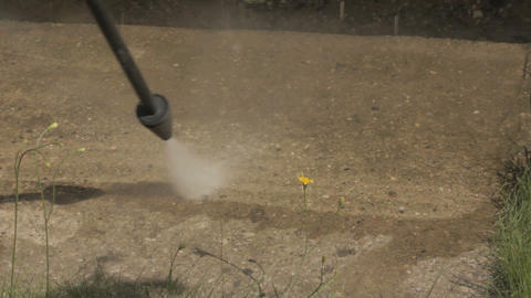 Cleaning dirty patio with pressure washer Stock Video Footage
