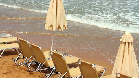 Sun beds by the sea. A peaceful holiday Footage