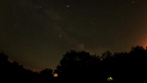 Time lapse of stars behind mountain Stock Video Footage
