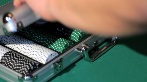 Hands close the aluminium suitcase with poker set Stock Video Footage