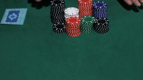 Casino Games. Poker Player going all-in Stock Video Footage