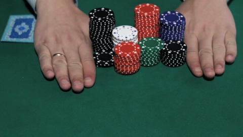 Casino Games. Poker Player going all-in Footage