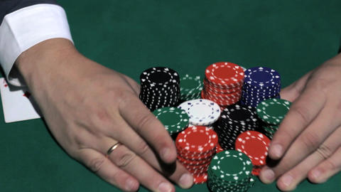 Poker players wins and takes the money Stock Video Footage