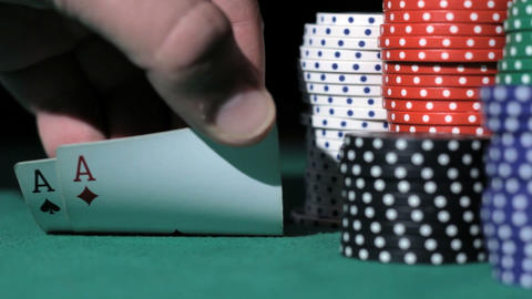 Player reveals his hole cards, two aces Stock Video Footage