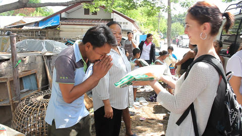 Handing Out Rice In The Slums Stock Video Footage