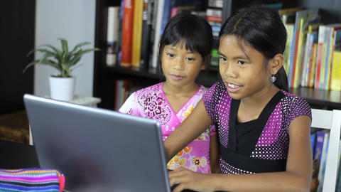 Young Asian Sisters Having Fun On Their Computer Stock Video Footage