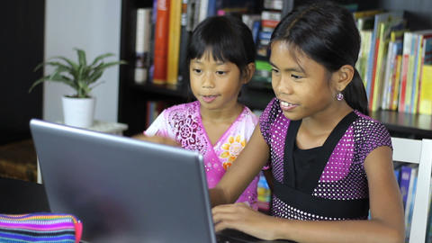 Young Asian Sisters Having Fun On Their Computer Footage