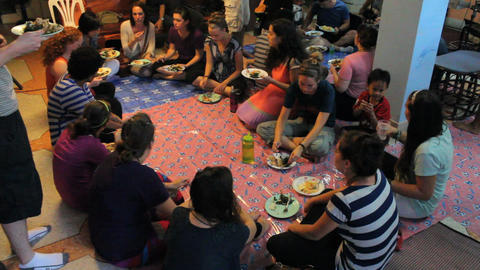Young People Gather For Special Dinner Overseas Stock Video Footage