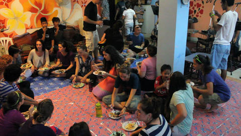 Young People Gather For Special Dinner Overseas stock footage