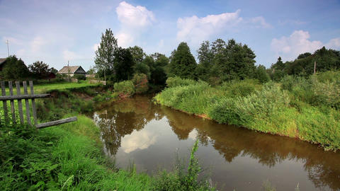 Movement of clouds over the river Polomet. Dvorets Stock Video Footage