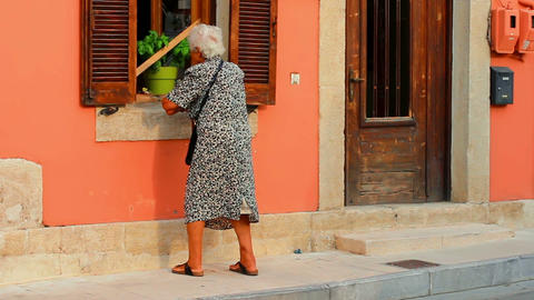 The old woman on the street Stock Video Footage