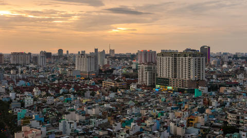 1080 - CITY SUNSET - ZOOM on HO CHI MINH CITY TIME Stock Video Footage