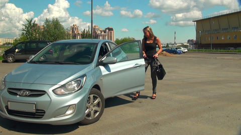Blonde gets in the car Stock Video Footage