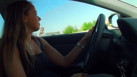 Blonde behind the wheel of the machine Footage