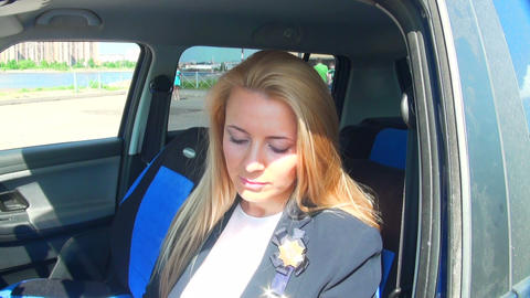 Blonde in the car paints her lips Stock Video Footage