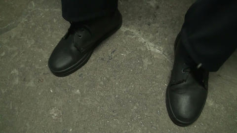 A man cleans shoes Stock Video Footage