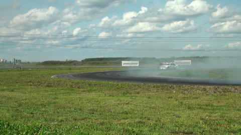 Auto racing. The smoke from under the tires Footage