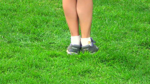 A teenager jumps on the grass Footage