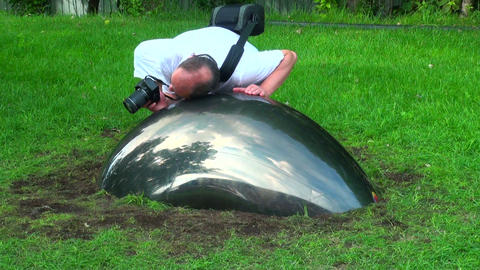 Art object. The hemisphere on the lawn Stock Video Footage