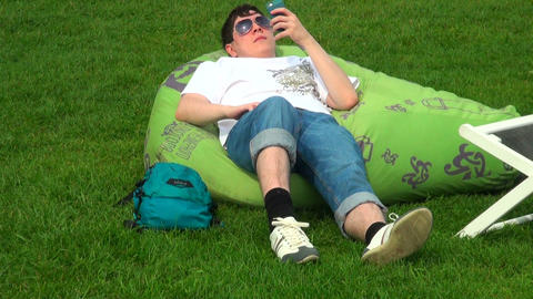 The guy is resting on the grass Stock Video Footage