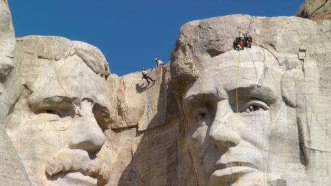 Men rappelling down Mount Rushmore National Memori Footage