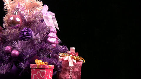 Pink Christmas tree rotates. Close-up Stock Video Footage