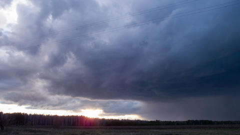 Sunset in the rain clouds. Time Lapse Footage