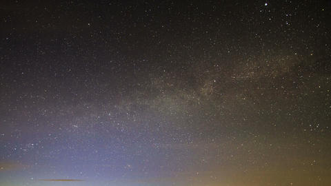 Milky Way rotates around the pole star, then dawn. Footage
