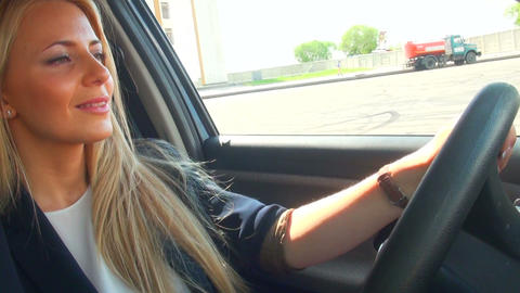 Blonde behind the wheel of the machine Stock Video Footage
