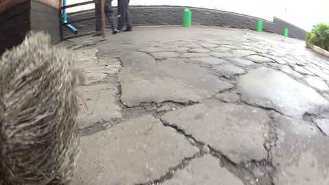 Broom sweeps a road Stock Video Footage