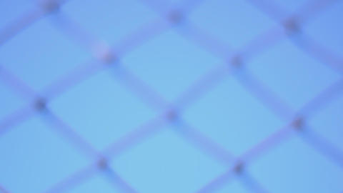 Metal Fence. Rack Focus And Dolly In stock footage