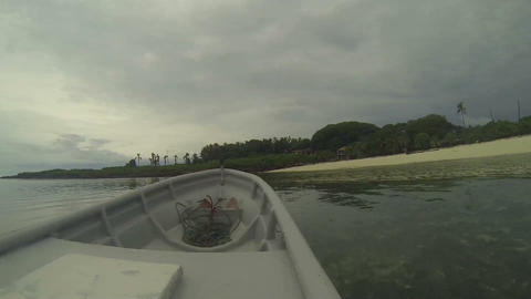Boat arriving to a beautiful tropical island Stock Video Footage