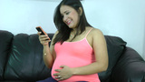 happy pregnant woman holding cell phone in her han Footage