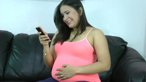 happy pregnant woman holding cell phone in her han Stock Video Footage