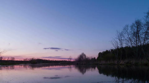 Sunset over the river, clouds are reflected in wat Stock Video Footage