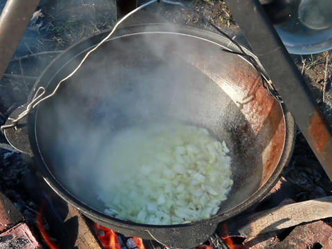 Cooking pilaf. Roast onions Stock Video Footage