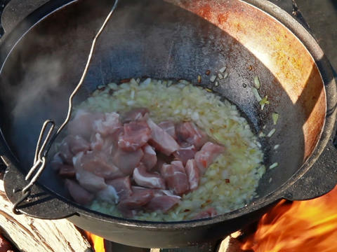 Cooking pilaf.Stewed meat Stock Video Footage