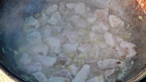 Cooking pilaf. Boils Stock Video Footage