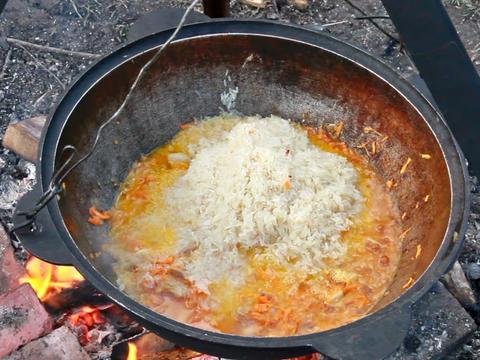 Cooking pilaf. Flatten rice Stock Video Footage