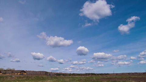 Clouds form over the field Stock Video Footage