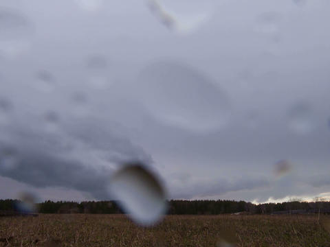 Rain and sun. Drops on the lens. Time Lapse. 4x3 Footage