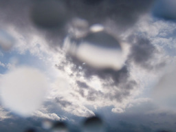Rain and sun. Drops on the lens. Time Lapse Stock Video Footage