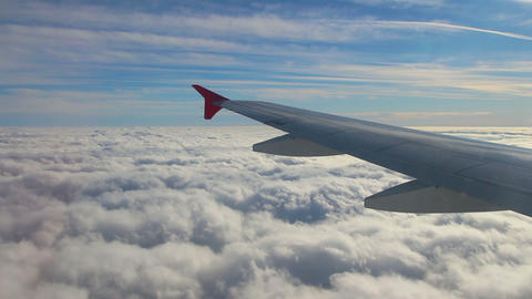 looking on wing and sky from airplane Stock Video Footage